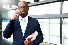Young Businessman on Phone Looking at Camera.jpg