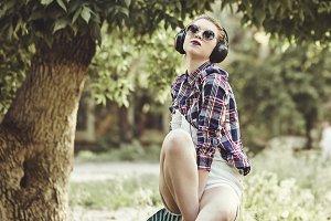 Hipster girl listening to music