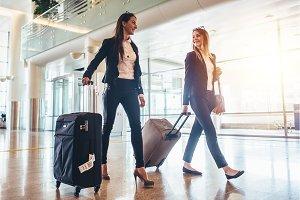 Two stylish female travelers walking