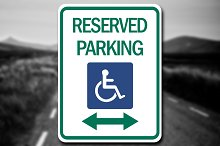 Handicap Reserved Parking Sign Decal by Nicholas Ritter in Metal