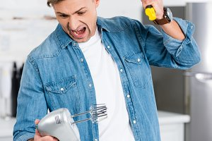 aggressive adult man screaming while