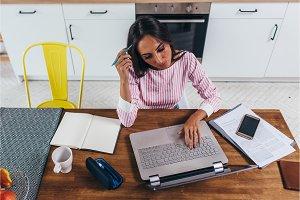Female freelancer work on laptop
