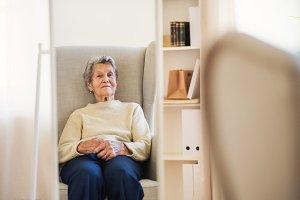 A portrait of a senior woman sitting