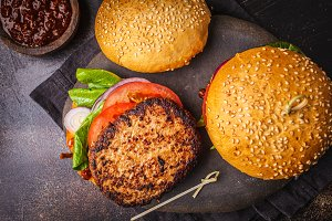 Traditional burgers with meat, sauce