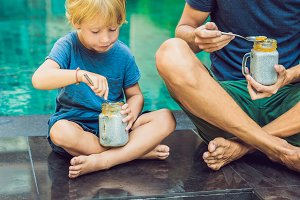 Father and son eat dessert with chia