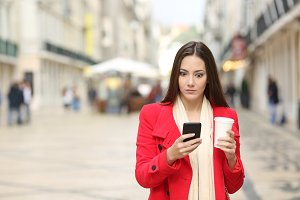 Perplexed woman using a smart phone