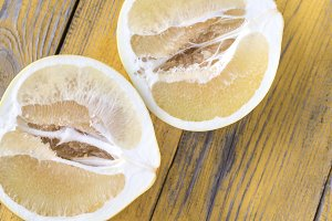 Pomelo on the wooden table