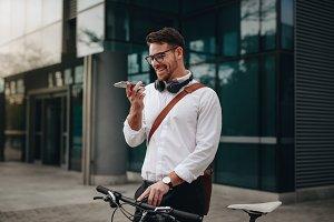 Smiling businessman talking on mobil