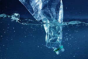 a Plastic water bottle pollution in