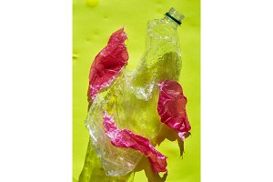 a Plastic bottle pollution on yellow
