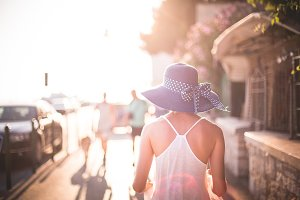 Beautiful Girl with Hat in Sun