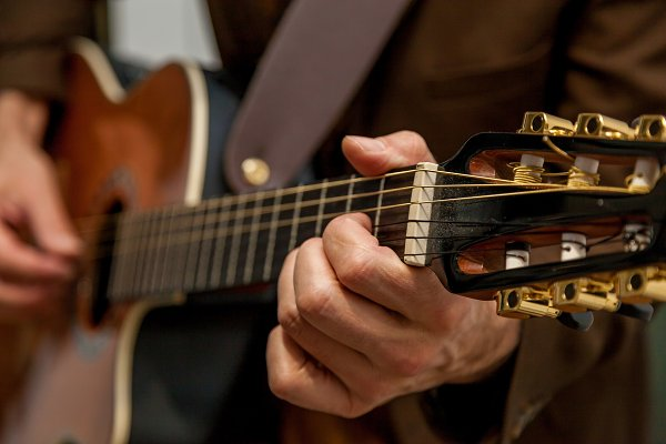 Holiday Stock Photos: Photostock - musician plays guitar close up