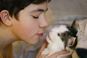 teenager boy with cat kissing hug ph