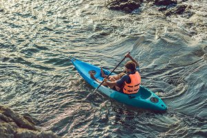 Father and son kayaking at tropical