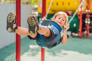 Funny kid boy having fun with chain