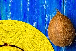 Yellow beach hat coconut on blue