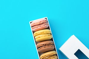 Multicolored macarons in gift box