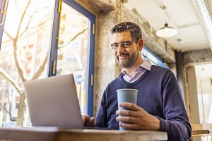 Middle aged businessman in a coffee