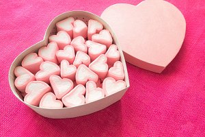 Pink marshmallow in a gift box in fo