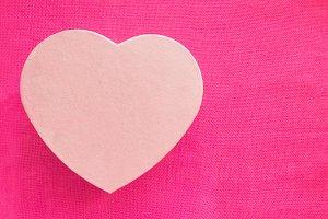 Heart shape gift box over pink backg