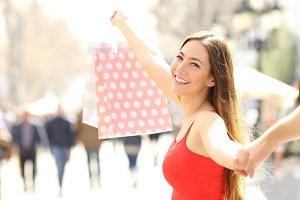 Happy shopper walking showing shoppi
