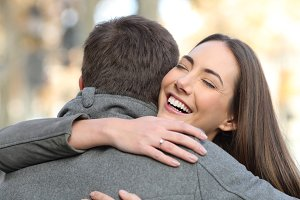 Couple hugging after happy proposal