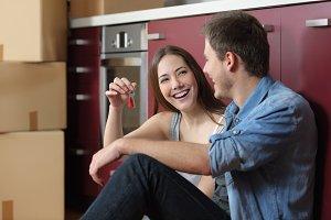 Happy tenants showing new home keys