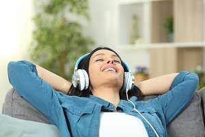 Happy woman resting listening to mus