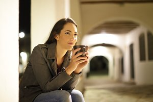 Relaxed woman drinking coffee in the