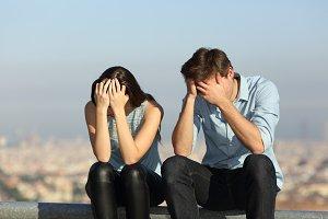 Sad couple complaining after argumen