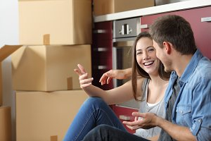 Smiley couple moving home talking on
