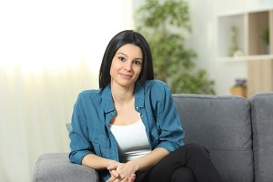 Woman posing at home looking at came