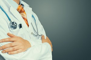 Unrecognizable Male Doctor In White