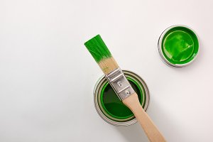 Green paint canister and brush top
