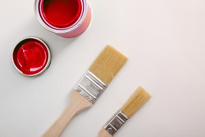 Red paint canister and brush top
