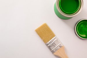 Open green acrylic paint canister