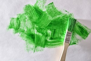 Abstract green paint and paint brush