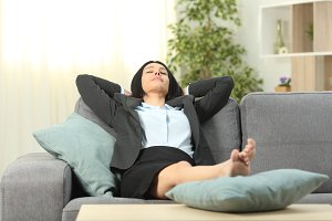 Office worker resting at home after