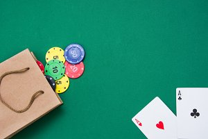 cardboard bag and poker cards