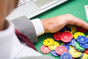 man with poker chips in hands