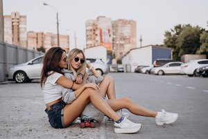 Two young, sexy girls are sitting on