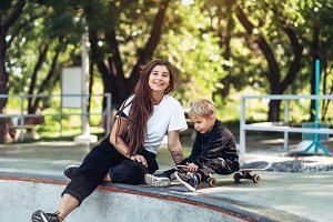 Beautiful young hipster mom and litt