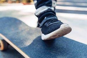 Boy legs on the skateboard close up