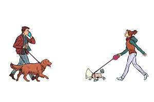 man and woman walking with dogs