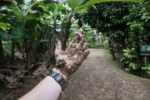 Dirty hand full of dirt in tropical