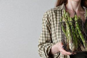 Woman holding fresh asparagus
