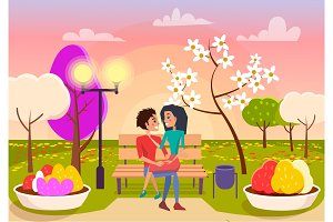 Couple in Love Sits on Bench in Park