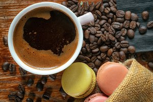 Black coffee cup and macarons