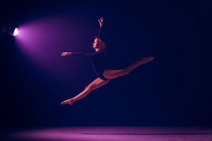 Young female ballet dancer on neon