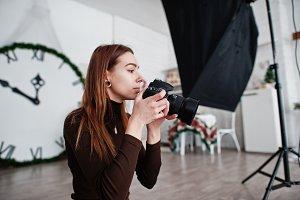Young girl photographer shooting on